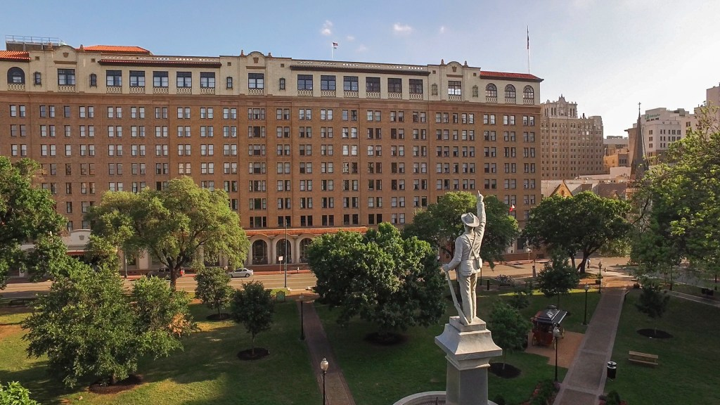 The St Anthony Hotel overlooking Travis Park