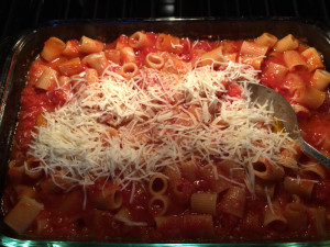 Dry pasta, canned tomatoes, olive oil bake together in the oven are a dream team to be mixed with Parmesan cheese!