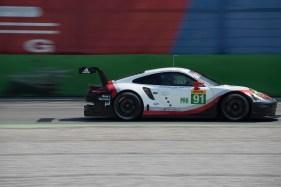 "Porsche 911 RSR with Richard Lietz at the Ascari Chicane. Nikon D810, 310 mm (80-400.0 mm ƒ/4.5-5.6) 1/160"" ƒ/10 ISO 64"