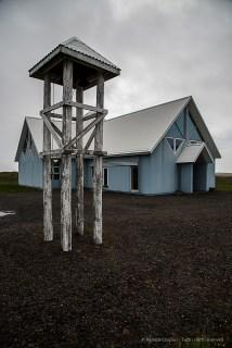 Church and bell tower approaching Höfn. Nikon D810, 24 mm (24-120.0 mm ƒ/4) 1/800 sec ƒ/8 ISO 200