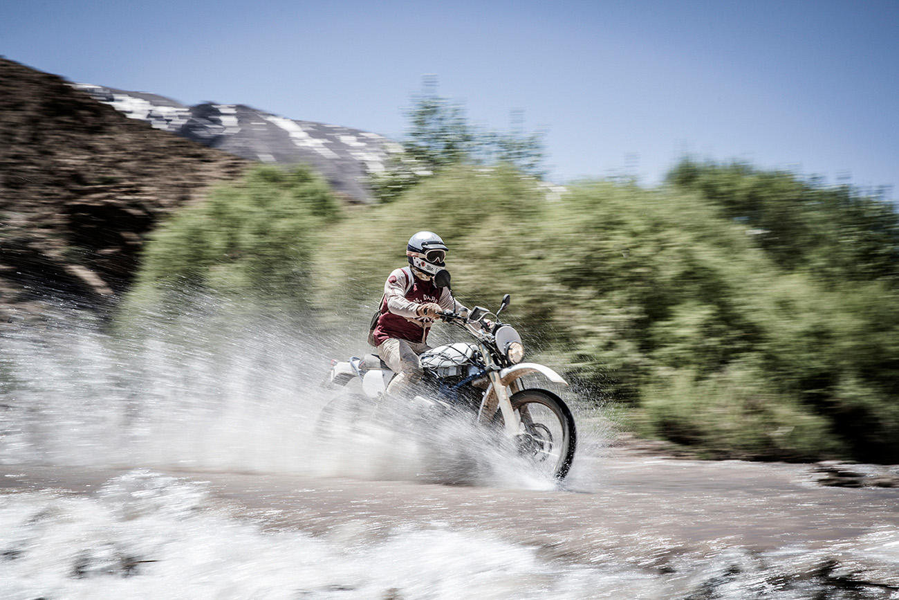 Scram Africa 2019, Custom Scrambler riding in a shallow river