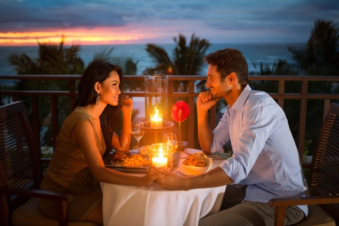 Romantic couple have dinner with sunset and candlelight outdoor, concept love, relationship and romantic
