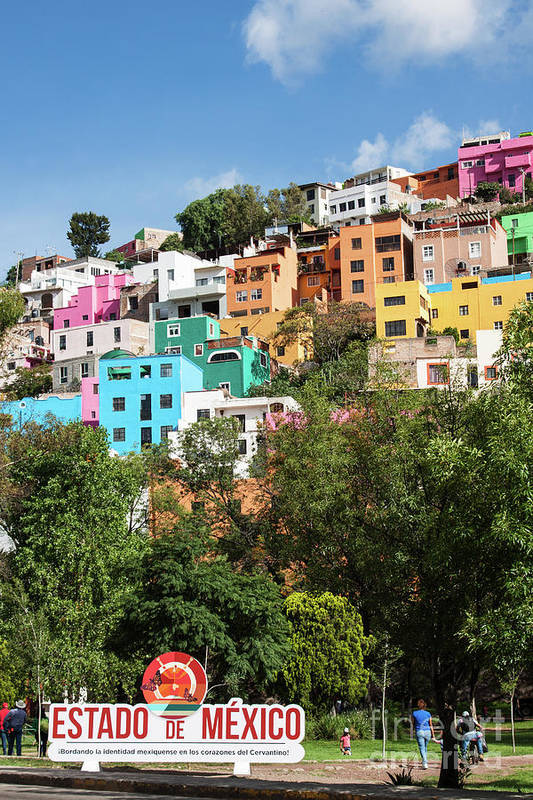 Colorful Hilltop Buildings And Sign In Guanajuato, Mexico by Tatiana Travelways