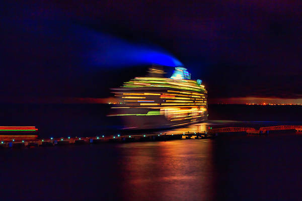 Cruise ship night departure in motion