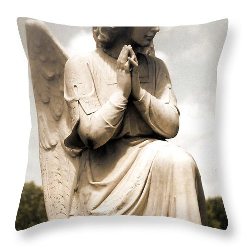 angel in prayer kneeling guardian angel of compassion throw pillow