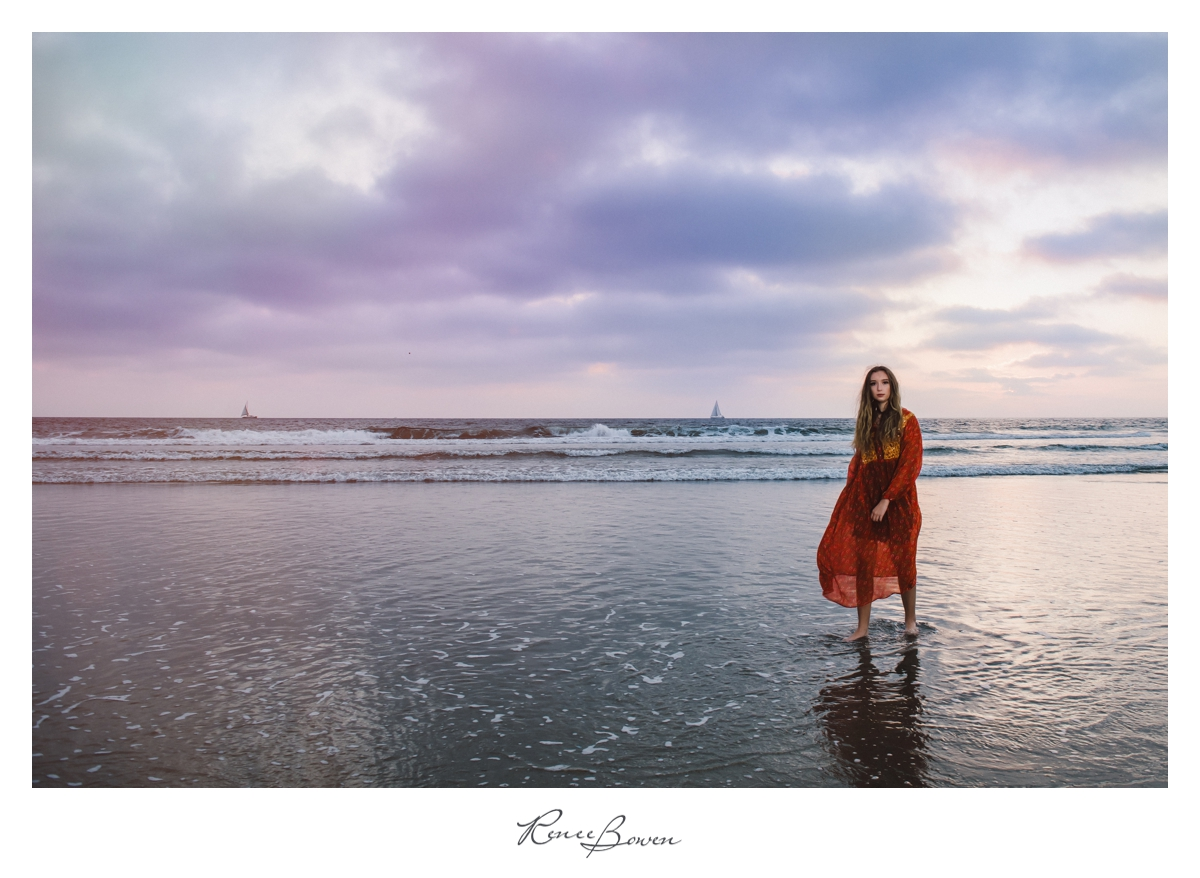 girl in red dress on beach sunset