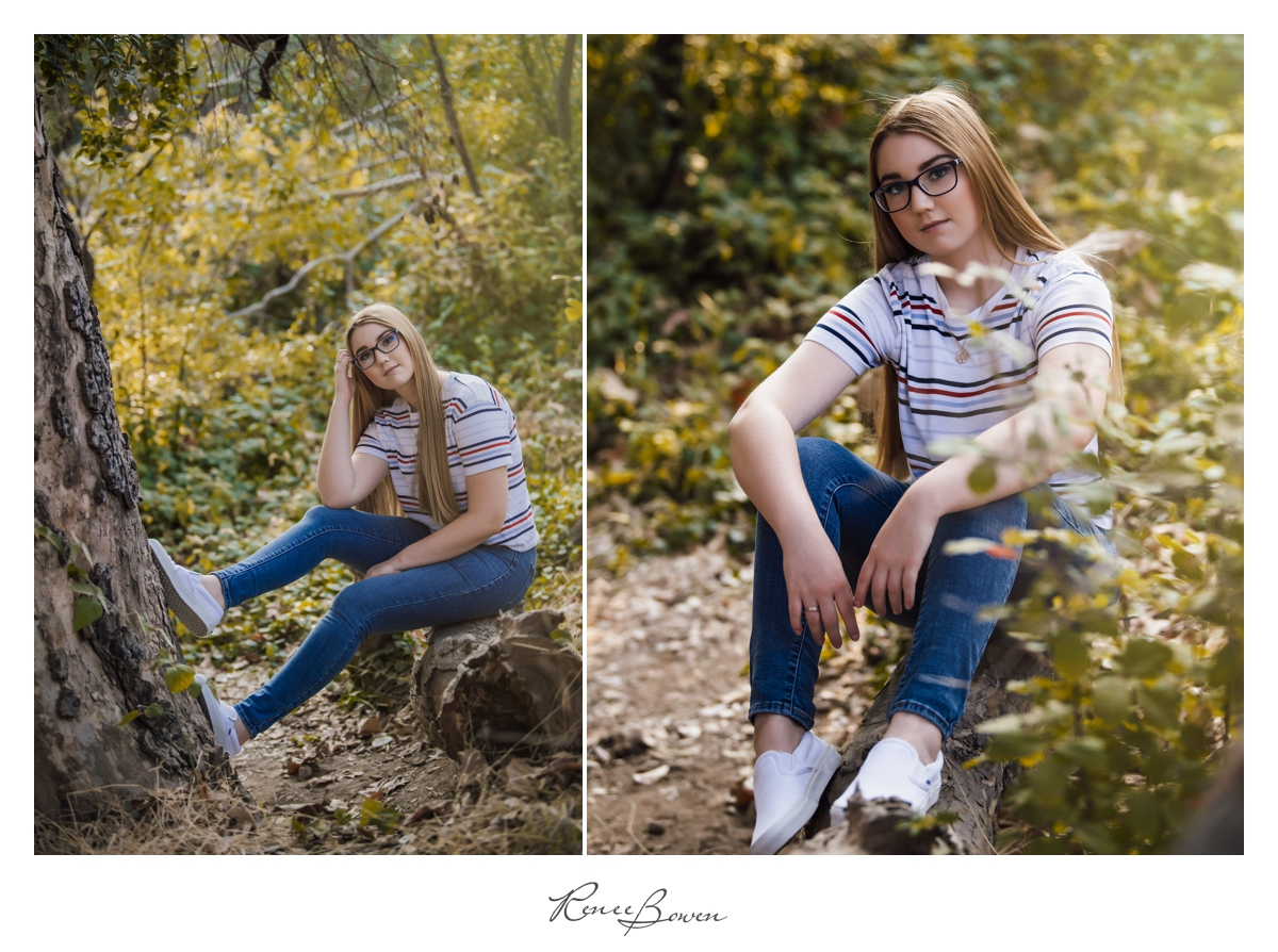 teen girl with jeans sitting on a log