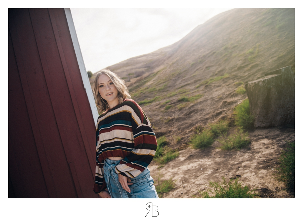 girl in striped top blue jeans outdoor senior session renee bowen