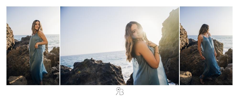 girl at beach wearing flowing blue long sundressback lit Renee Bowen Seniors