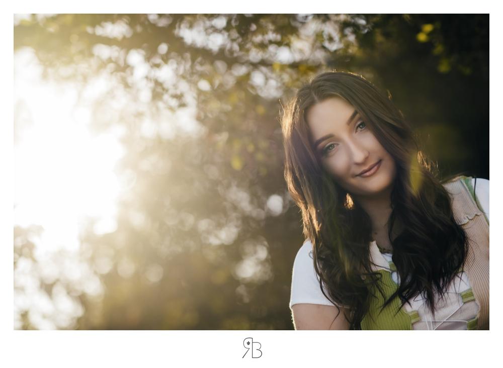 close up girl in trees backlit renee bowen seniors