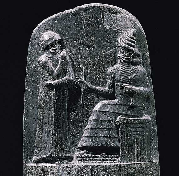 King Hammurabi and the god Shamash, from the diorete stele on which the Codex Hammurabi is engraved.
