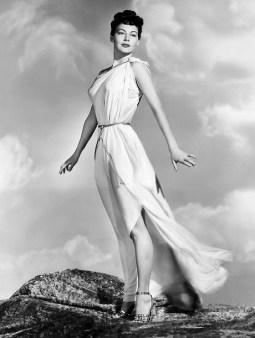 """7/20/1948- Hollywood, CA- The breeze toys with the classic Grecian costume of a modern Venus as she stands high on a Hollywood hilltop. Luscious Ava Gardner, who stars in the forthcoming """"One Touch of Venus"""", lends her beauty--and her arms--to the Twentieth Century conception of the legendary glamor girl."""