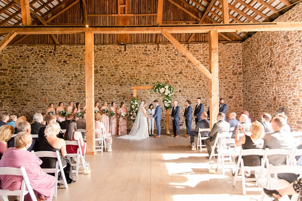 French Creek Golf Club wedding ceremony in barn photographed by Renee Nicolo Photography