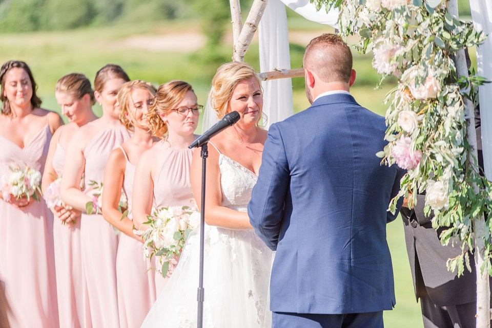 bride and groom exchange vows during French Creek Golf Club photographed by Renee Nicolo Photography