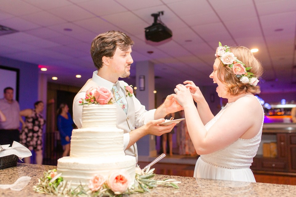 bride and groom cut cake from Sweet Dispositions photographed by Renee Nicolo Photography