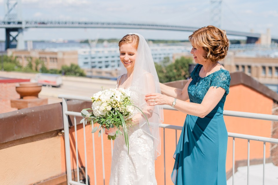 Renee Nicolo Photography photographs bride and mother putting veil on