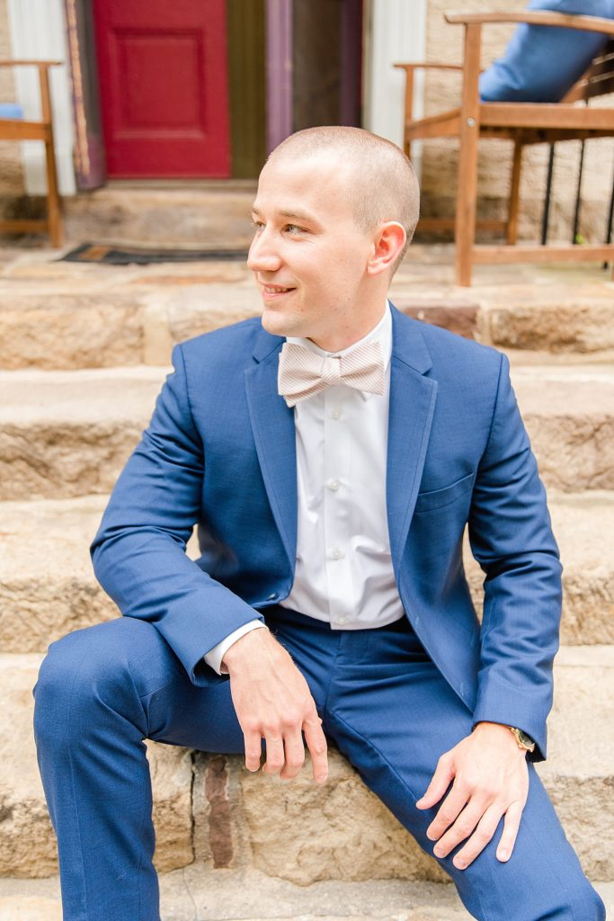 groom portraits in navy suit photographed by Renee Nicolo Photography