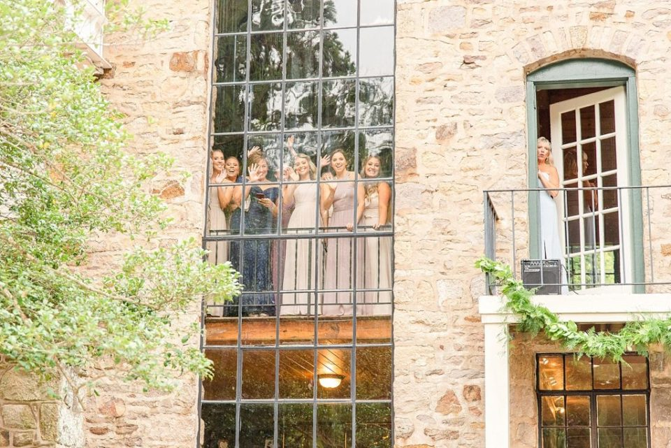 bridesmaids and mothers watch first look photographed by Renee Nicolo Photography