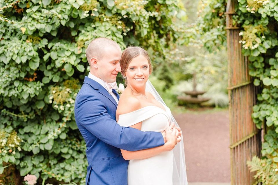 bride and groom pose for Renee Nicolo Photography