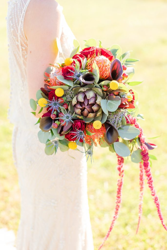 wedding bouquet with red, orange and yellow florals for fall photographed by Renee Nicolo Photography