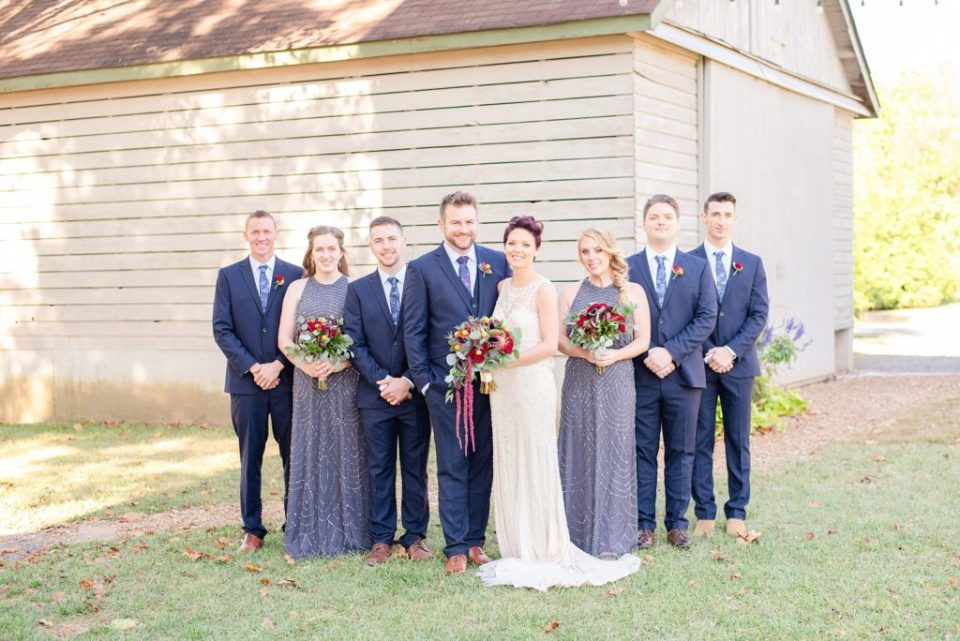 bride and groom with bridal portrait by Renee Nicolo Photography