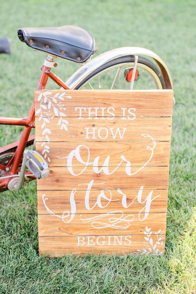 wooden sign welcoming guests to wedding photographed by Renee Nicolo Photography