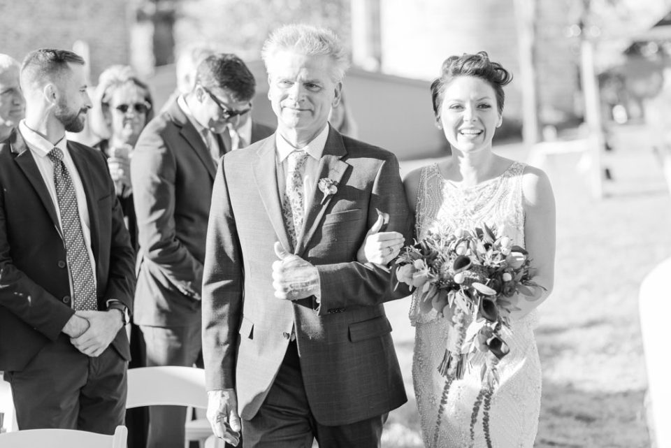 bride enters wedding day in Bucks County PA with Dad photographed by Renee Nicolo Photography