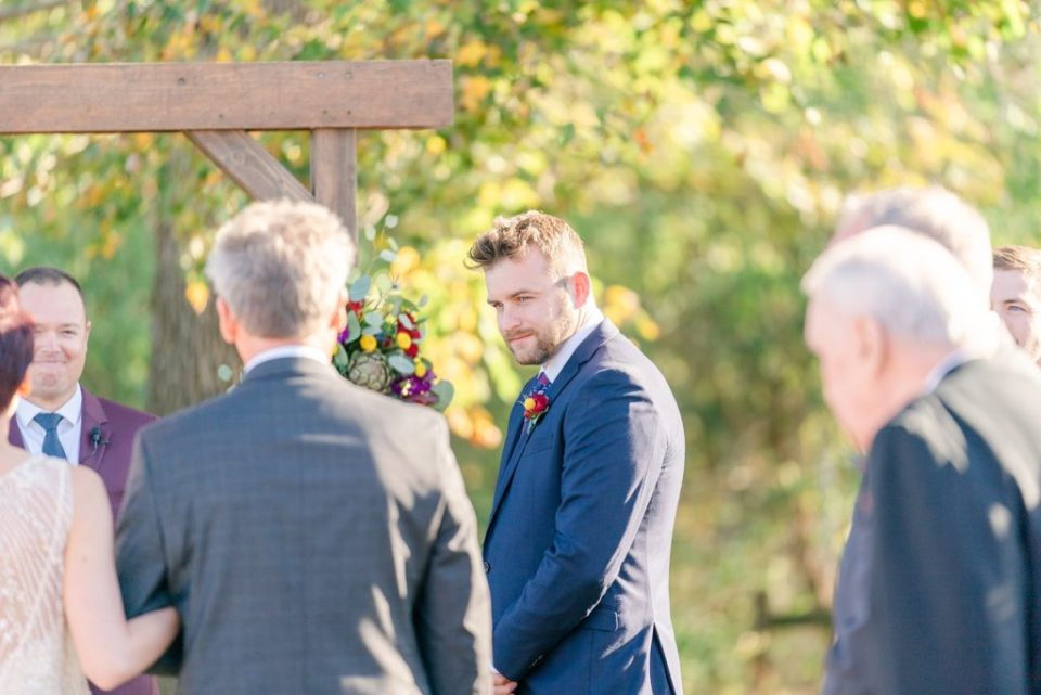 groom sees bride during wedding ceremony photographed by Renee Nicolo Photography