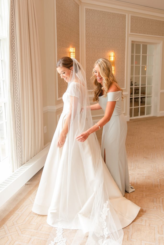 bride and sister prepare for PA wedding day with Renee Nicolo Photography