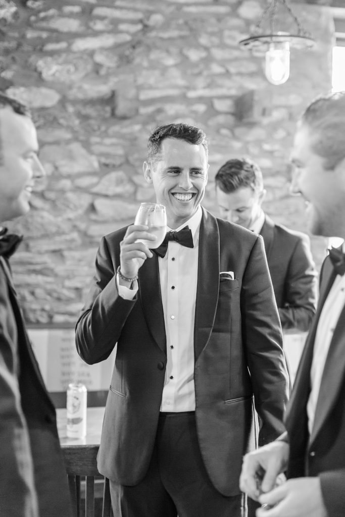 groomsmen enjoy a drink before wedding photographed by Renee Nicolo Photography