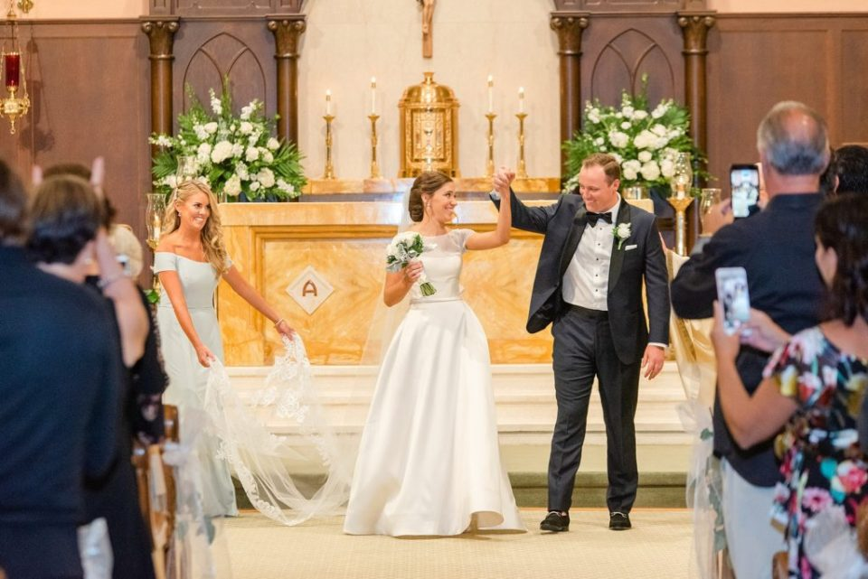 bride and groom recess up aisle photographed by Renee Nicolo Photography