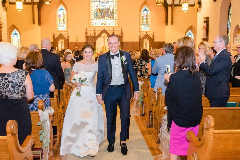newlyweds leave church photographed by Renee Nicolo Photography
