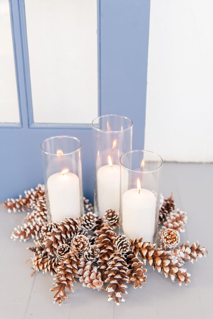 pinecone and candle decor for fall wedding day with Renee Nicolo Photography