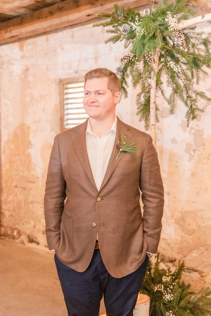 groom watches bride walk down aisle photographed by Renee Nicolo Photography