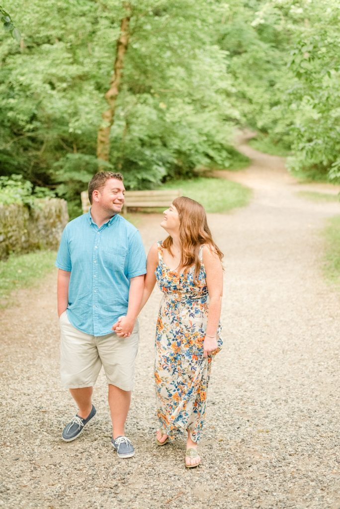 bride and groom walk in local park photographed by Renee Nicolo Photography