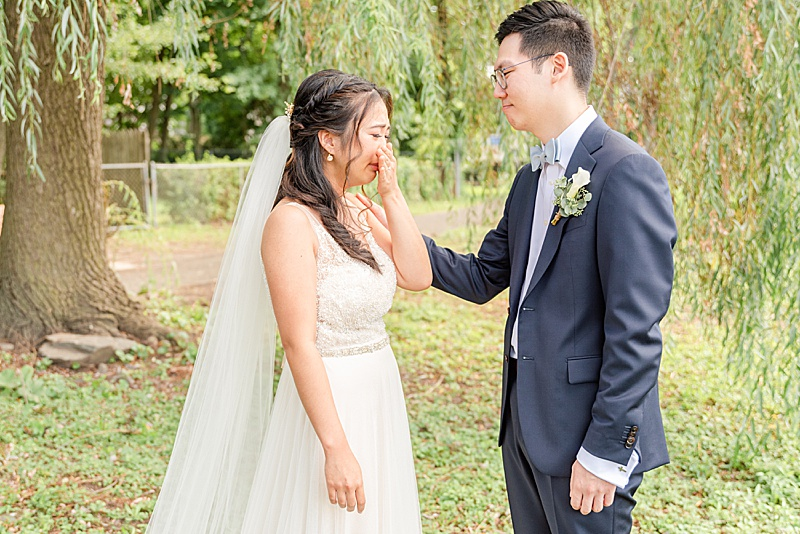 emotional bride during first look in New Jersey