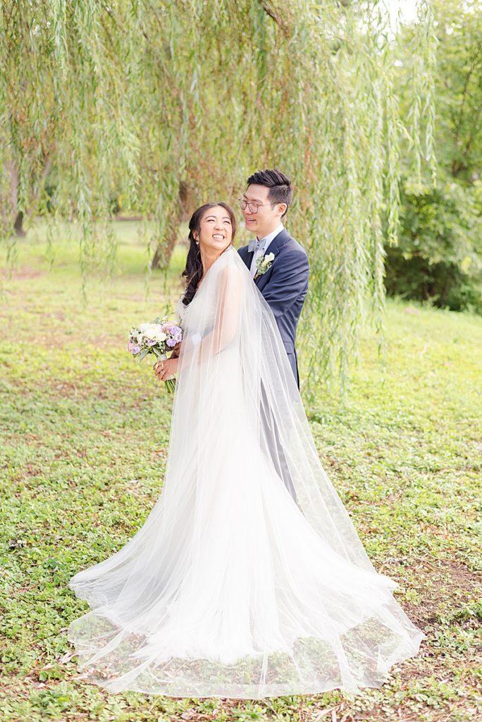 bride looks at groom before NJ backyard wedding