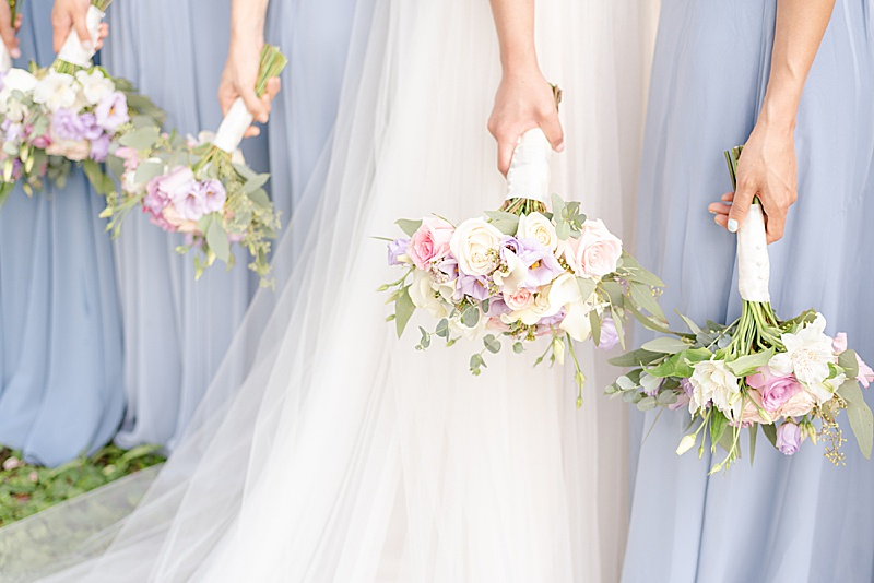 wedding bouquets for bridesmaids in dusty blue gowns