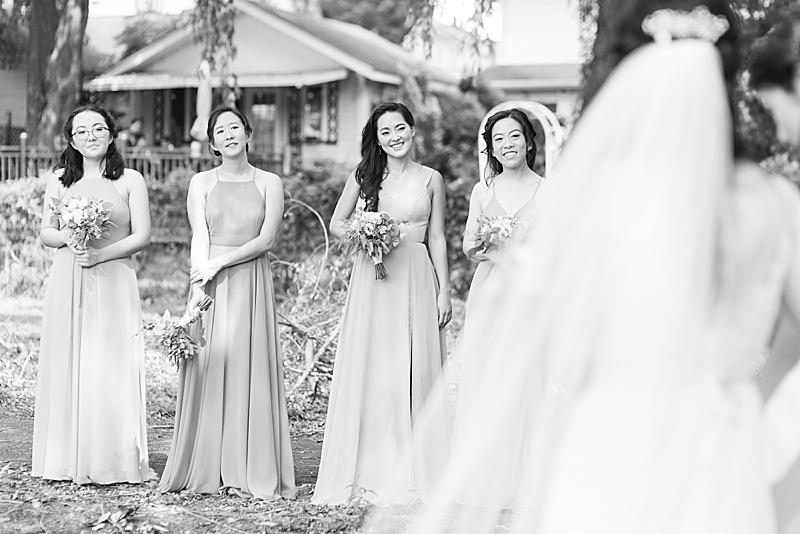 bridesmaids watch bride during portraits
