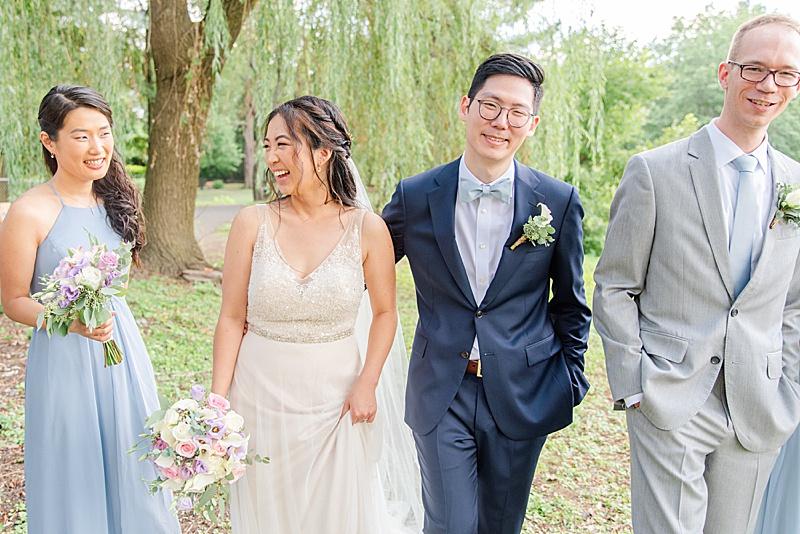 bride and groom walk at Cooper Pond Park