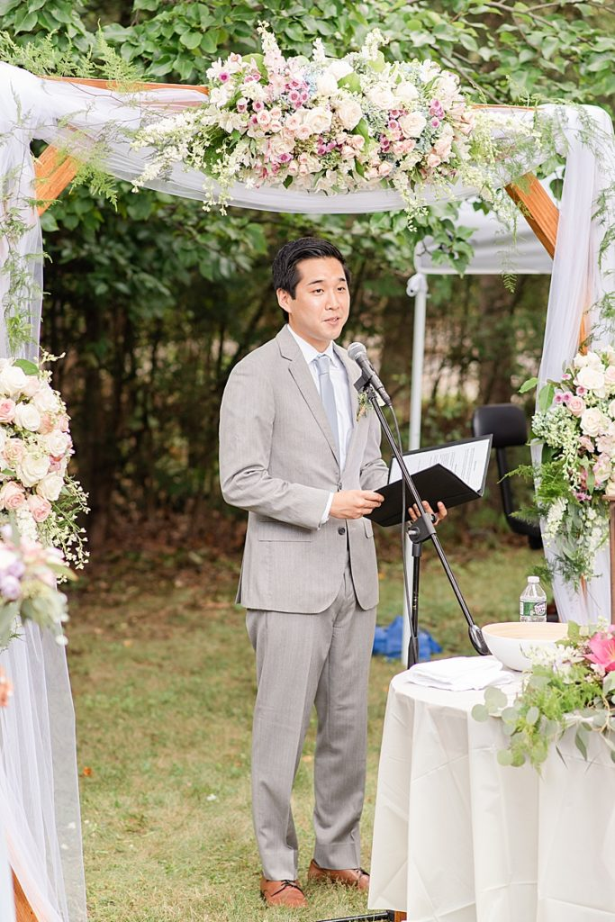 officiant reads during NJ backyard wedding ceremony