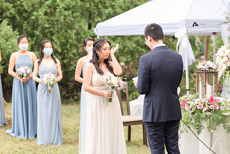bride cries listening to groom's vows