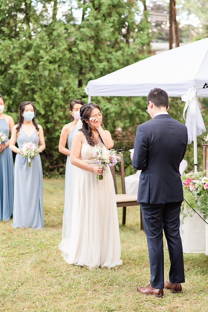 bride cries during wedding ceremony in New Jersey