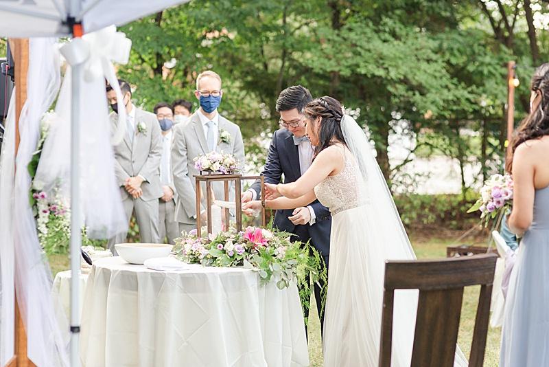 unity candle in backyard wedding