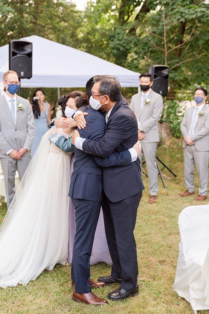 parent hugs during ceremony