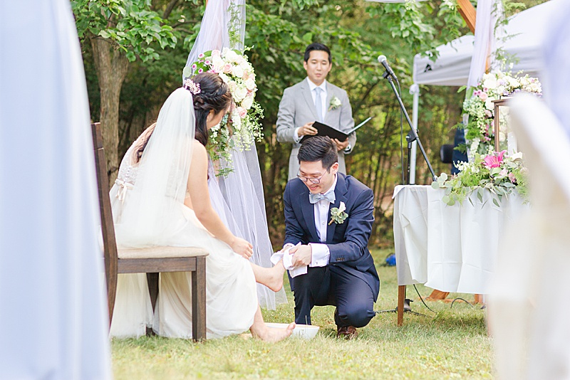 groom washes bride's feet
