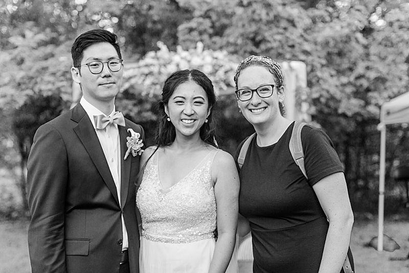 Renee Nicolo poses with New Jersey bride and groom