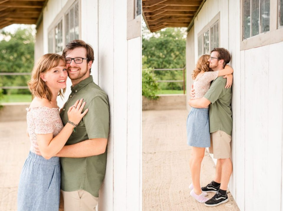 couple poses by farm building on Historic Stonebrook Farm