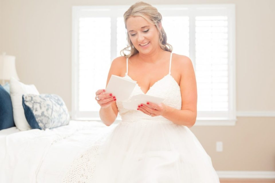 bride reads card from groom on wedding morning
