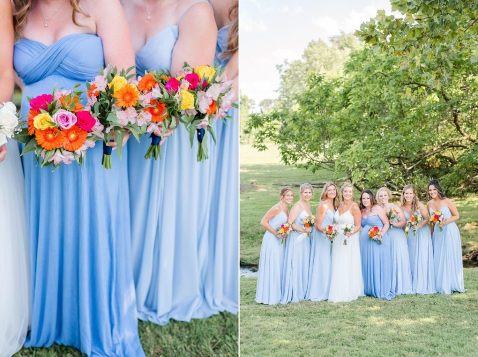 bridesmaids in blue gowns hold colorful lowers